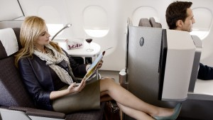 Female_passenger_reading_a_magazine_in_new_IB_A330_business_class_seat