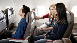 Female_passengers_use_IFE_in_new_IB_A330_economy_class_seat