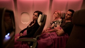 Passengers_sleeping_in_new_IB_A330_economy_class_seats