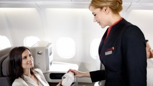 Stewardess_distributing_amenity_kit_to_female_passenger_on_new_IB_A330