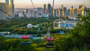 Colourful cable cars and cityscape of Dalian city