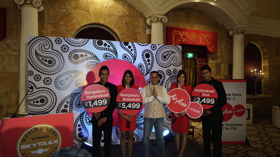 Amar Abrol, CEO, AirAsia India along with the cabin crew at the press conference announcing induction of the 7th aircraft and new routes.