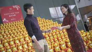Qatar Duty Free's 450 lucky waving cats installation at Hamad International Airport