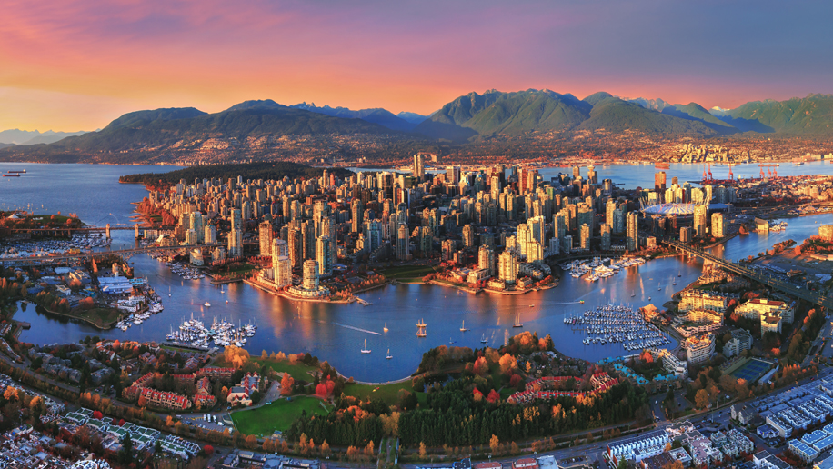 Aerial sunset over Vancouver - Credit: Tourism Vancouver/ Frannz Morzo Photography