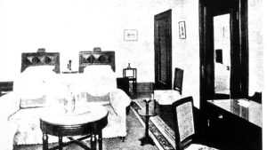 An early bedroom scene from The Peninsula hotel