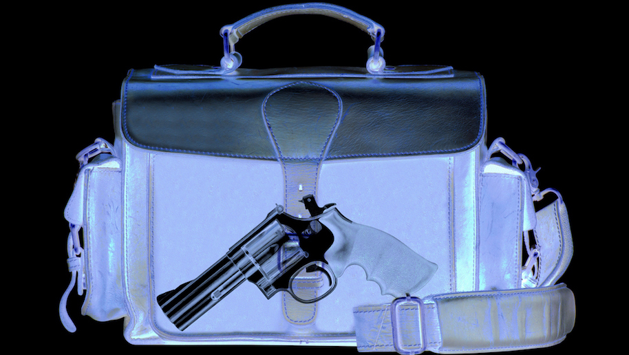 Xray scan detects weapon in briefcase (iStock)