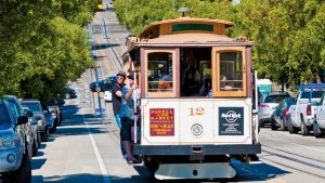 San Francisco iconic cable car with tourists California USA