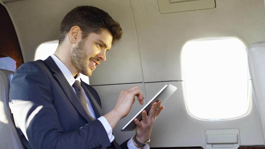 Man using tablet (SITA stock image)