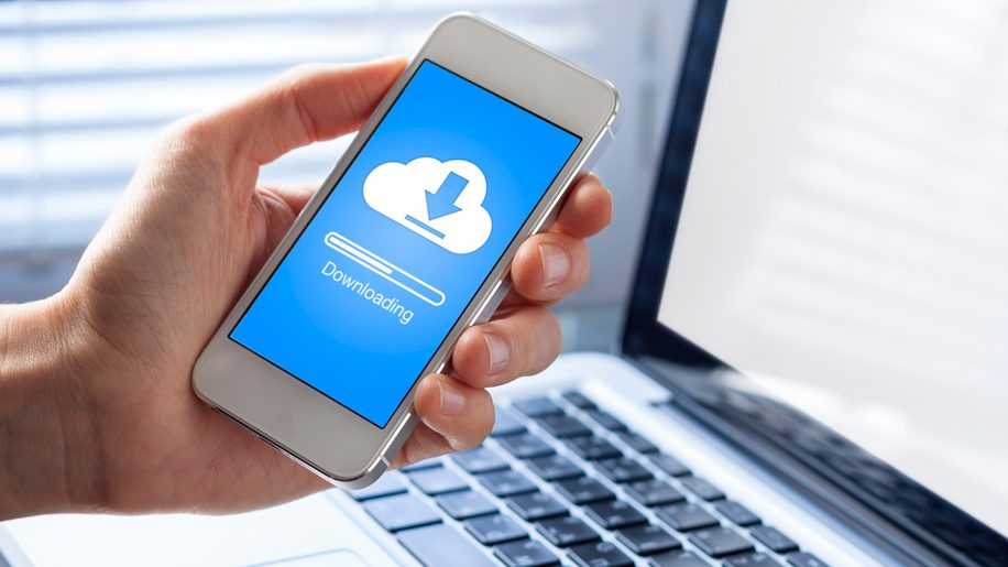 Cloud downloading on mobile phone (iStock)