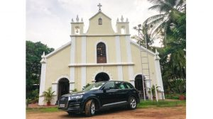 The SUV parked in front of a church in Goa