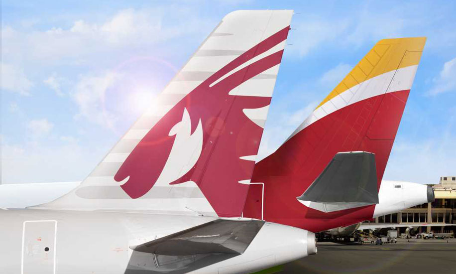 Qatar Airways and Iberia tail fins