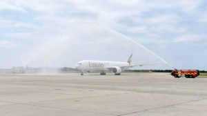 Emirates B777-300ER arrives at Stansted with water cannon.