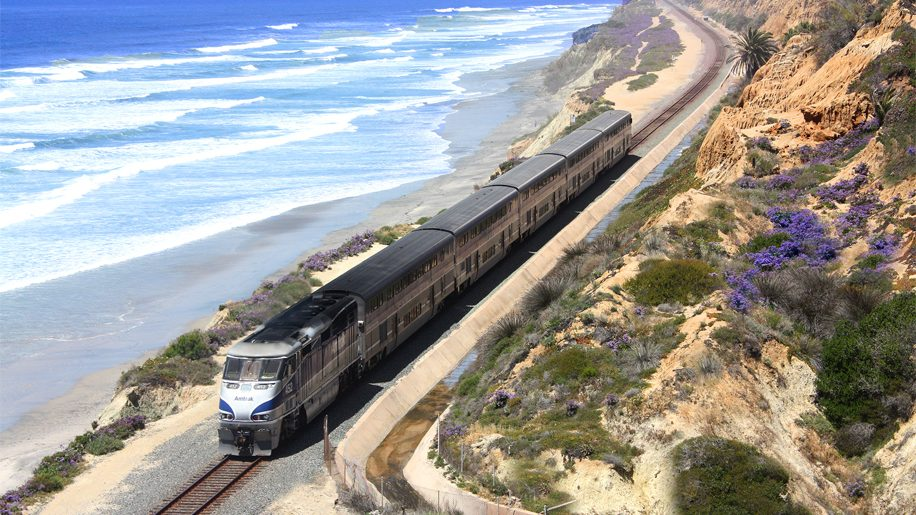 Amtrak's Pacific Surfliner travels along the coastline in Del Mar, California. The service connects San Luis Obispo and San Diego through Los Angeles and Santa Barbara