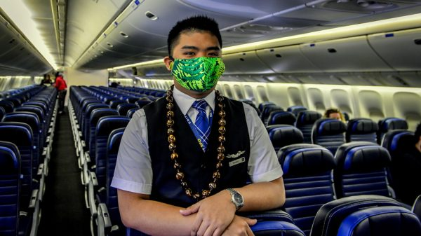 United Airlines flight attendant wearing face masks