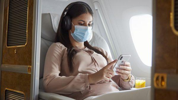 Emirates passenger wearing a mask